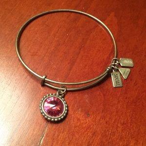 Silver bracelet with pink gem